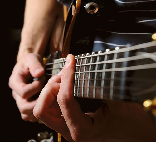 Hands Playing Guitar