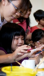 School kids painting in ArtScience Museum
