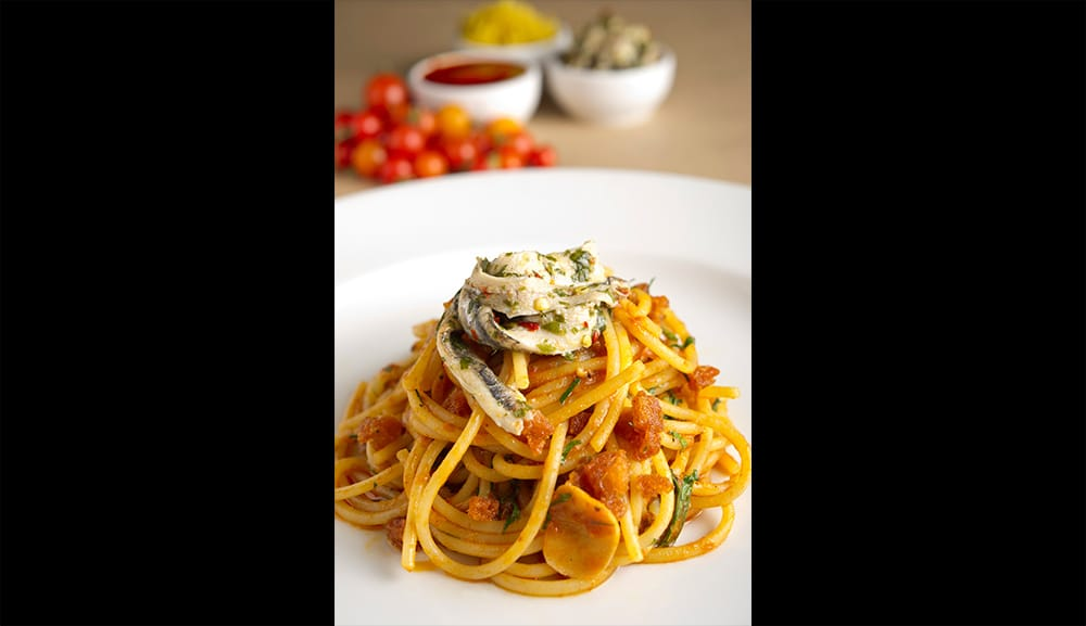 Spaghetti alla Calabrese with spicy tomato, lemon & marinated white anchovies
