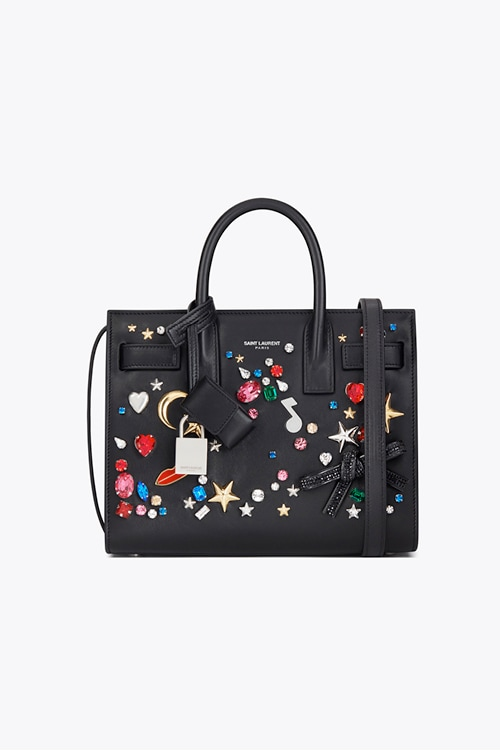 Crystals and brass embellished leather bag from Saint Laurent - Front Row